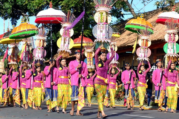 Balinese people take part in a parade du