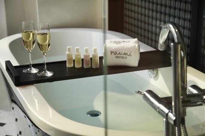Bathtub Showcasing Malin + Goetz Toiletries