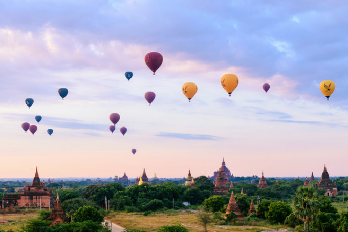 Hot air Balloons flying over the pagodas at sunrise, Bagan, Myanmar